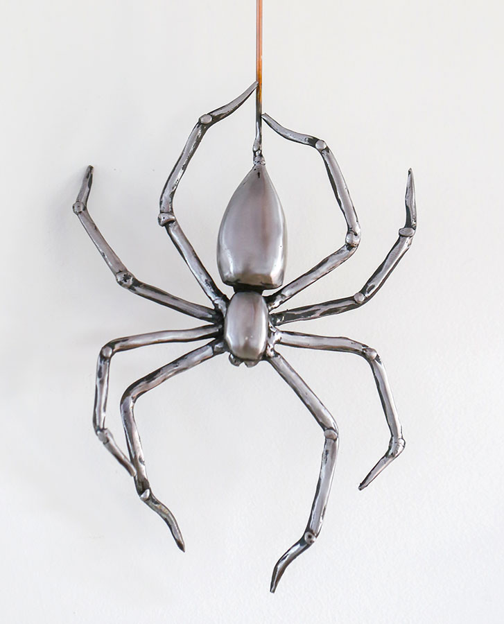 unique hand crafted iron spider on copper wire
